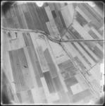 FD-4299-283 Verticale luchtfoto van de polders Binnenland en Nieuw-Reijerwaard met de Dordtschestraatweg (van links ...