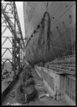RDM-11220-11 De bouw van het SS Nieuw Amsterdam (2) op de werf van de Rotterdamsche Droogdok Maatschappij met apostelen ...