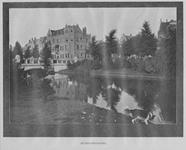 IX-1155-01 Heemraadssingel met op de achtergrond de Heemraadsbrug.