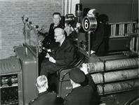 XXXIII-1354 Wethouder J.U. Schilthuis gezeten tussen brandweermannen in een brandweerauto tijdens de opening van de ...