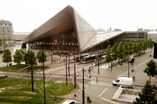65 Bovenaanzicht van het Weena, het Stationsplein met tramhaltes en het Centraal Station.