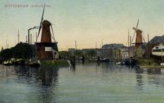 PBK-1 Voor- en Achterhaven. In het midden molen De Distilleerketel en rechts molen De Waakzaamheid.