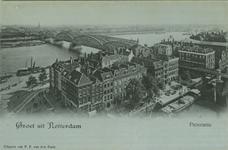 PBK-1983-562 Spoorbrug en de Willemsbrug over de Nieuwe Maas. Op de voorgrond de Scheepmakershaven, de Hertekade en het ...