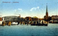 PBK-1987-1099 De Koninginnebrug over de Koningshaven en de spoorbrug. Rechts de toren van de Kerk van de H.H. ...