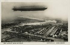 PBK-1987-1225 De Graf Zeppelin boven Nieuwe Maas en Noordereiland. Op de achtergrond de Koningshaven en de wijk Feijenoord.