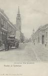 PBK-2768 Gezicht in de Havenstraat met links de Sint-Anthonius Abtkerk en rechts het torentje van het nog bestaande ...