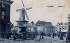 PBK-290 Molen De Noord aan het Oostplein.Tot 1912 stond daar het overblijfsel van de Oostpoort. Links ervan rijdt een ...