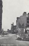 PBK-3153 Gezicht op de door het Duitse bombardement van 14 mei 1940 getroffen Hoogstraat. Als gevolg van dit ...