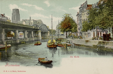 PBK-3377 Kolk, uit het zuidoosten. Achter het spoorwegviaduct panden aan het Westnieuwland en de Sint-Laurenskerk. ...