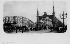 PBK-4098 De Willemsbrug uit het noorden. Links een gedeelte van de spoorbrug over de Nieuwe Maas.