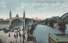 PBK-4165 De Willemsbrug en de spoorbrug over de Nieuwe Maas, vanuit het zuiden, naar de Boompjes toe.