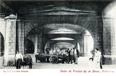 PBK-419 Zicht onder het spoorwegviaduct onder Station Beurs, uit het zuiden.