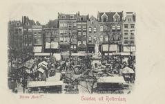 PBK-4867 Nieuwemarkt uit het westen. Rond het monument De Maagd van Holland wordt de rommelmarkt gehouden.