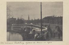PBK-4928 De nieuwe Noorderbrug over de Rotte tijdens de bouw in 1911. Op de achtergrond de toren van de ...