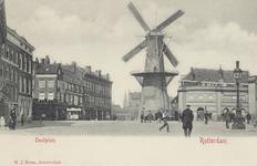 PBK-5144 Oostplein met op de achtergrond molen De Noord, vanaf het Oostmolenwerf. Op de achtergrond de toren van de ...