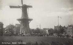 PBK-5158 Molen De Noord aan het Oostplein. Links het Achterklooster en rechts de Goudsesingel, uit het oosten.