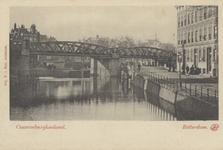 PBK-5768 Gezicht op de stadsvest (de latere Pompenburgsingel) met daarover de spoorbrug. Rechts de Langebrug over de ...