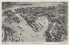 PBK-5983 Luchtopname van de Nieuwe Maas, het Noordereiland , de Koningshaven en rechts de Rijnhaven. Op de achtergrond ...