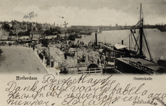 PBK-843 De toegang tot de Oudehaven, het Bolwerk en de Oosterkade met op de achtergrond het Maasstation, rechts de ...