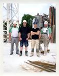 2012-26 Vier bouwvakkers op een bouwplaats. De foto is gemaakt in opdracht van De Kracht van Rotterdam (DKVR).