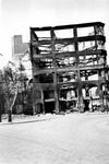 1985-380 Gezicht op de door het Duitse bombardement van 14 mei 1940 getroffen Mosseltrap. Uit het zuiden. Als gevolg ...