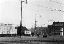 1989-2700 Reclamebord nabij de politiepost op het Marconiplein. Op de achtergrond de Mathenesserdijk.