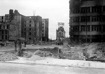 1991-3153 Restanten van gebouwen aan de Hoofdsteeg na het Duitse bombardement van 14 mei 1940. De Hoofdsteeg gezien ...