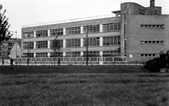 1992-73-TM-75 Lange Hilleweg.Van boven naar beneden gezien:73: De Openbare school voor GLO, uit zuidelijke richting ...