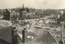 2001-1388 Puinresten na het bombardement van 14 mei 1940. Beschadigde huizen aan de Almondestraat, de Schoterbosstraat, ...