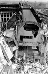 2001-1732 Puinresten na het bombardement van 14 mei 1940. De Botersloot met het telefoongebouw.