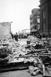 2001-1873 Puinresten na het bombardement van 14 mei 1940. De Botersloot met rechts de gemeentebibliotheek en de ...