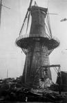 2001-2023 Gezicht op de door het Duitse bombardement van 14 mei 1940 getroffen Oostplein met de gespaard gebleven molen ...