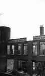 2004-545 Gezicht op de door het Duitse bombardement van 14 mei 1940 getroffen Schiestraat met restant van kinderwagen ...