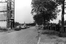 2005-9100 De Rechter Rottekade met op de achtergrond de toren van de Nieuwe Noorderkerk aan de Snellemanstraat. Rechts ...