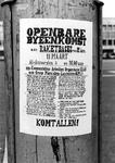 2005-9650 Een affiche aan paal op het Schouwburgplein met protest en oproep voor openbare bijeenkomst op 11 maart aan ...