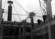 XIV-50-51-01-14 Puinresten na het bombardement van 14 mei 1940. Gezicht in het nieuwe Beursgebouw. Verwoesting . Blok ...