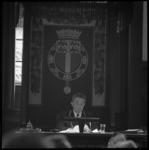 10400 Voorzitter van de Rijnmondraad, mr. V.G.M. Marijnen, zit, met ambtsketen, op voorzittersstoel in de ...