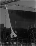 1059-1 Het motorvrachtschip Karachi bij C. van den Giessen en Zonen werd wel gedoopt maar door te lage waterstand van ...
