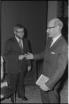 22529-7-21 Tweede-Kamerlid Hans van den Doel (links), zojuist gepromoveerd tot doctor in de economische wetenschappen, ...