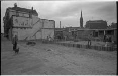 23709-1-7 Oude woonhuizen aan het Goudseplein en de aanleg van een speelplek op het afgebroken gedeelte.