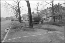24623-3-15 Snoeien en rooien van door stormen beschadigde bomen op het Noordplein. Als voorbode van een geheel nieuw ...