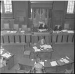 43 Wethouder H.E. van den Brule als loco-burgemeester in de gemeenteraadszaal Rotterdam.