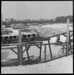 6945 Werkzaamheden in verband met aanleg van de randweg Noord; langs de spoorbaan en over de Rotte.