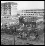 7597 Brand na explosie in een bouwkeet aan het Jacob van Campenplein in de Prins Alexanderpolder.