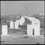 8956 Aanleg viaduct rijksweg A20, rechts en links industrie langs de Giessenweg, in de verte links de flats van het ...