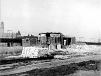 1977-3437 Gezicht op de Botersloot met restanten en de sloop van de synagoge, als gevolg van het Duitse bombardement ...