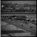291-02 Zicht op IJsselmonde met op de voorgrond de Stadionweg. Op de achtergrond de Nieuwe Maas.