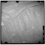 FD-4299-06 Verticale luchtfoto van de Holierhoeksche en Zouteveensche Polder met de Veenweg (onder) en de Harreweg ...