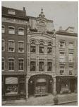 XXV-119 De Boymansstraat met de winkel van Bodega. Het pand links is een banketbakkerij.