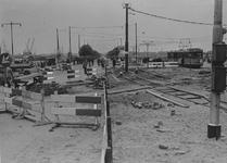 IX-1873 Marconiplein met opgebroken betrating in verband met verkeers wijzigingen. Op de achtergrond tram lijn 4 naar ...